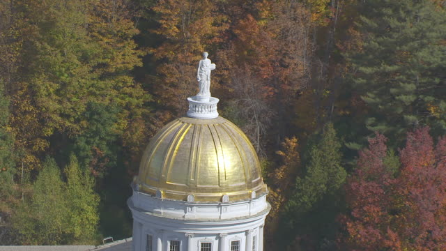 ws zo aerial pov ceres statue of vermont state house with autumn forest area / montpelier, vermont, unites states - vermont stock videos & royalty-free footage