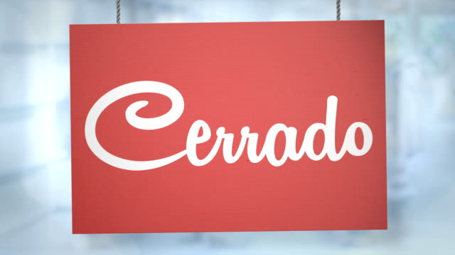 Cerrado sign hanging from ropes. Luma matte included so you can put your own background.
