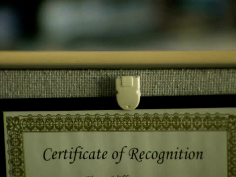 cu, certificate of recognition in frame - plakette stock-videos und b-roll-filmmaterial