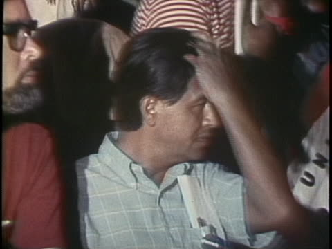 cesar chavez sits during a united farm workers rally where ted kennedy is in attendance - business or economy or employment and labor or financial market or finance or agriculture stock videos & royalty-free footage