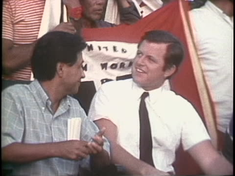 cesar chavez sits next to ted kennedy at a united farm workers rally in 1969. - メキシコ系アメリカ人点の映像素材/bロール