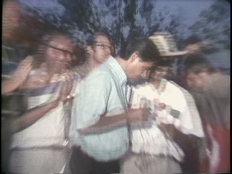 cesar chavez with ted kennedy at a united farm workers rally in 1969. - メキシコ系アメリカ人点の映像素材/bロール