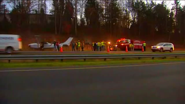 cessna 182 with three people on board landed on highway 29 outside lexington, nc. long static shot of emergency vehicles and plane on the side of the... - median nerve stock videos & royalty-free footage