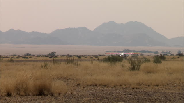 WS TS Cessna aircraft taking off from Sossusvlei / Sossusvlei, Namibia