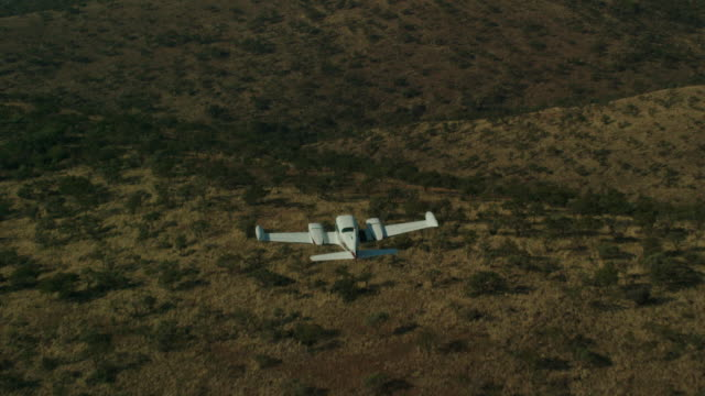 Cessna Flies Over Landscape 2