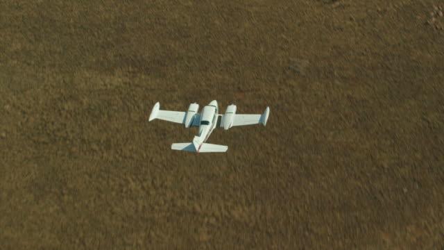 Cessna Flies Over Landscape 4