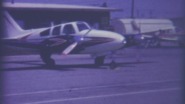 cessna fueling station 1950's - piloting stock videos and b-roll footage
