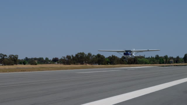 slo mo ms pan cessna plane landing at airport, burbank, california, usa - propeller aeroplane stock videos & royalty-free footage
