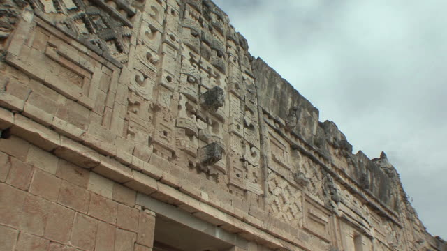 MS ZI CU Chaacs, Maya rain deity carvings on Northern building of Nunnery Quadrangle at pre-Columbian ruined city of Maya civilization / Uxmal, Yucatan, Mexico