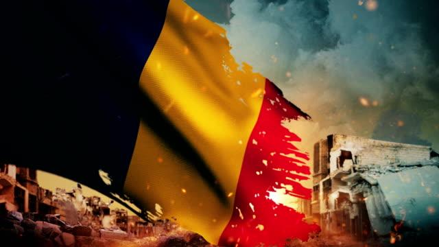 vidéos et rushes de 4k chad drapeau - crise / guerre / fire (boucle) - arme de destruction massive