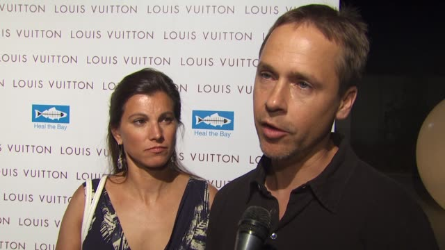 chad lowe and kim painter on tonight's event, on heal the bay, and on if they shopped at the new louis vuitton store in santa monica tonight at the... - chad lowe stock videos & royalty-free footage