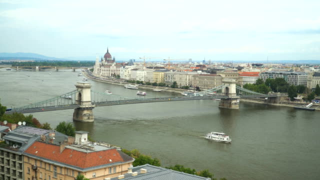 chain bridge and parliament under overcast, budapest, hungary - chain bridge suspension bridge stock videos & royalty-free footage