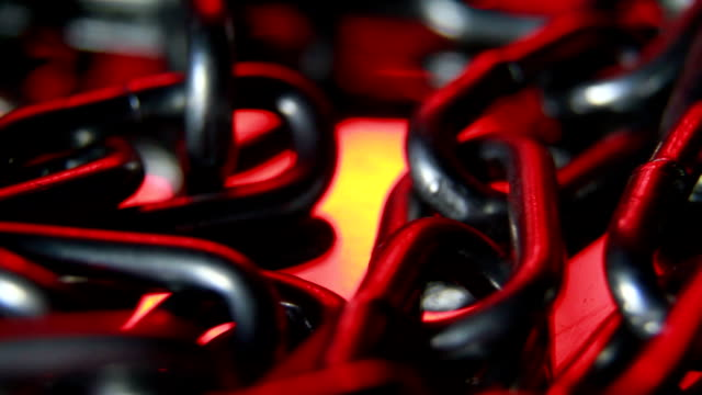 stockvideo's en b-roll-footage met keten in rood licht, loopbare achtergrond - ketting