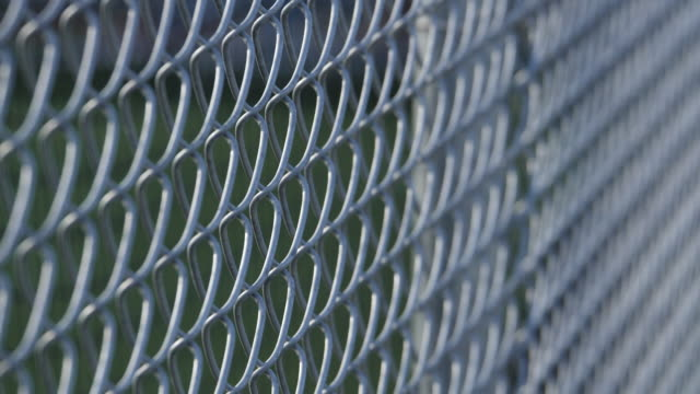 a chain link fence at a little league baseball game. - little league stock videos and b-roll footage