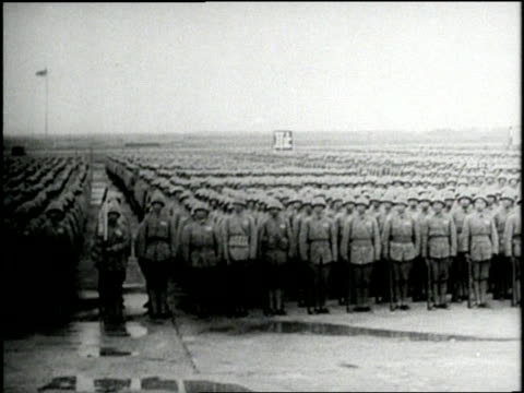 stockvideo's en b-roll-footage met chaing kai shek salutes a mass of chinese nationalist standing at attention who then march away with their weapons - chiang kai shek
