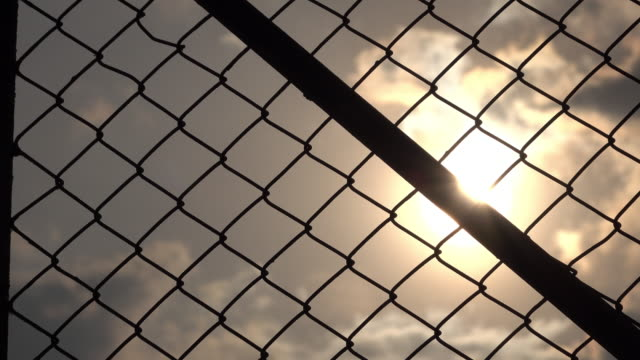 chainlink fence and sun sky - chainlink fence stock videos and b-roll footage