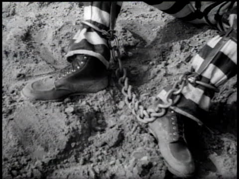 1938 cu chains on prisoner's legs / georgia, usa - 鎖点の映像素材/bロール