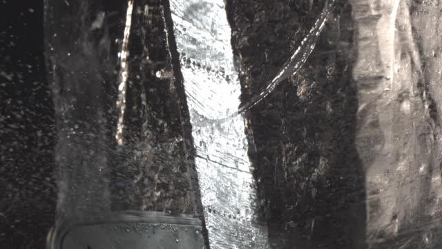 cu slo mo chainsaw cutting through block of ice / united kingdom - chainsaw stock videos & royalty-free footage