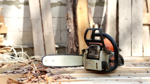 chainsaw on wooden planks. - construction material stock videos & royalty-free footage