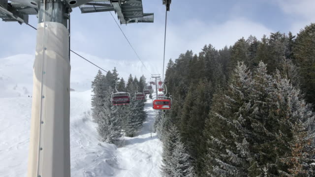 chair lift in lenzerheide switzerland - seggiovia video stock e b–roll