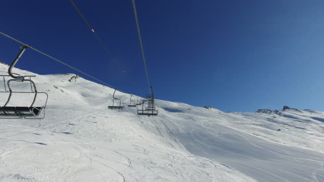 chair lift. the ski resort in winter in the french alps - stazione sciistica video stock e b–roll