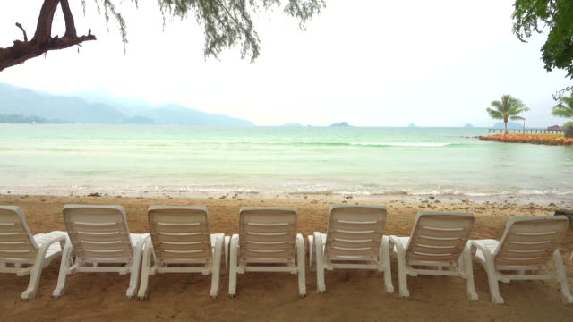 chair on sea beach - koh chang stock videos and b-roll footage