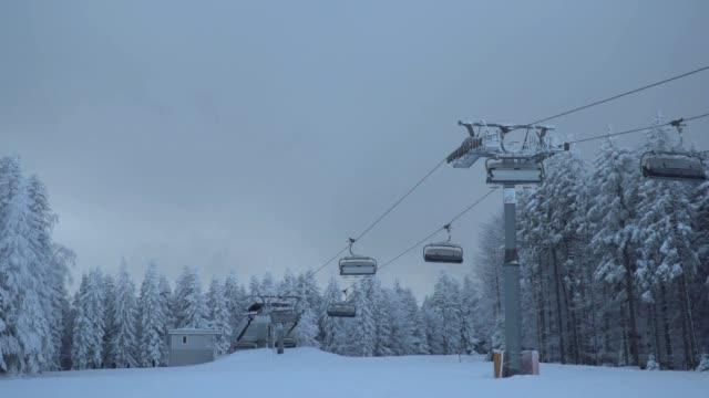 Chairlift driving over ski slope