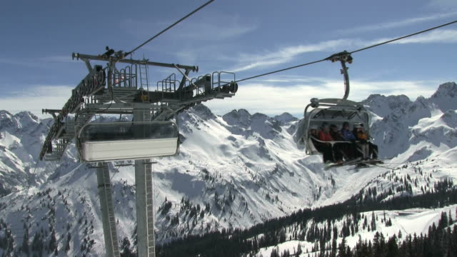 MS Chairlift with skiers at Mount Fellhorn at Allgäu Alps / Oberstdorf, Bavaria, Germany
