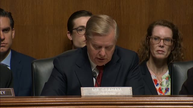 Chairman Lindsey Graham of South Carolina reads at a Senate Judiciary Committee hearing on the report of special counsel Robert Mueller from a text...