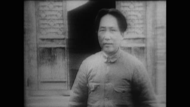 vídeos de stock e filmes b-roll de chairman mao divides the war against japan into three parts as people flock to join him at including his future wife then actress jiang qing - mao tse tung