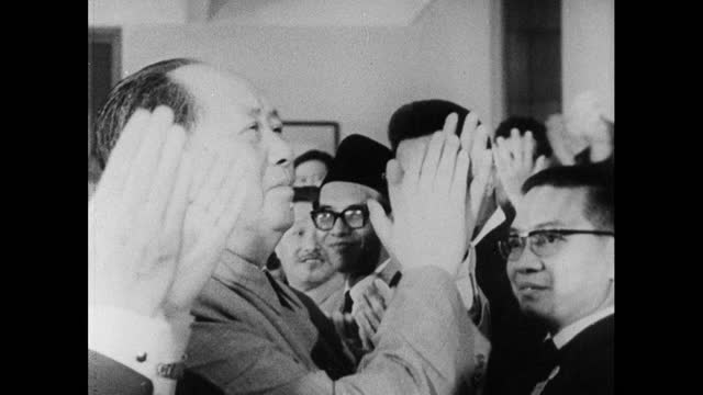 chairman mao tse-tung makes a public appearance in beijing, shaking hands of supporters and clapping the crowd; 1966. - maoism stock videos & royalty-free footage