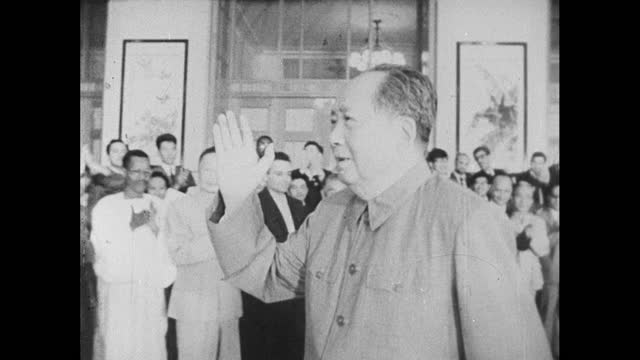 chairman mao tse-tung makes a public appearance in beijing, walking amongst a crowd clapping; 1966. - maoism stock videos & royalty-free footage
