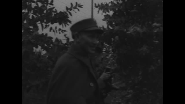 chairman of the national military council chiang kaishek passes camera and salutes with whitegloved hand pan from right to left allied commander in... - chiang kai shek stock videos and b-roll footage