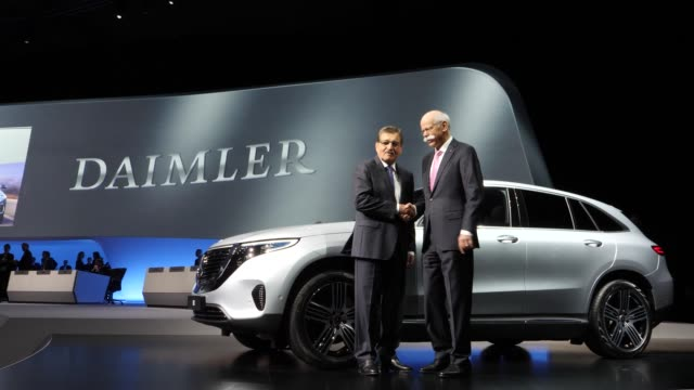 chairman of the supervisory board of daimler ag, manfred bischoff shake hands with dieter zetsche , chairman of daimler ag next to a mercedes eqc... - annual general meeting stock videos & royalty-free footage
