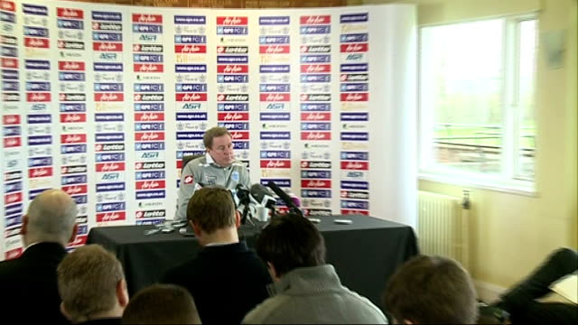 qpr chairman tony fernandes threatens to quit club middlesex harlington sports centre int wide shot redknapp press conference zoom in redknapp... - トニー・フェルナンデス点の映像素材/bロール