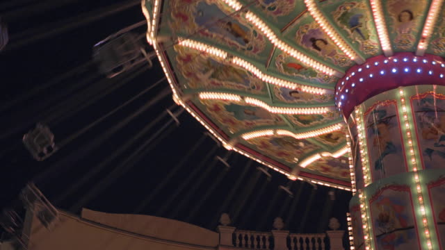 chairoplane at an amusement park spinning during the night - school fete stock videos and b-roll footage