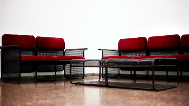 chairs and table in a waiting room - waiting room stock videos & royalty-free footage