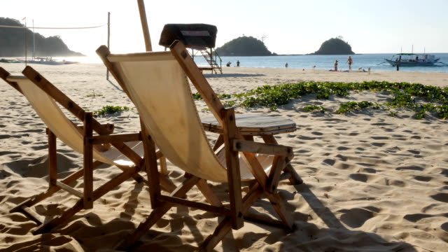 2 chairs at nacpan beach in el nido, philippines - beach chairs stock videos & royalty-free footage