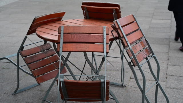 chairs collected from a closed bar terrace during coronavirus time. berlin. germany. - outdoor chair stock videos & royalty-free footage