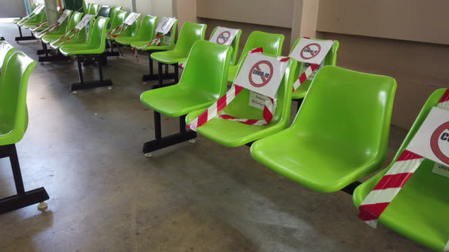 chairs for social distancing during covid-19 pandemic. - bench stock videos & royalty-free footage