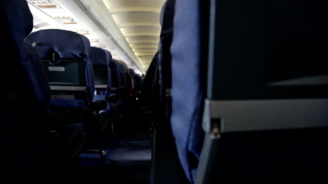 chairs in the plane - vehicle interior stock videos & royalty-free footage