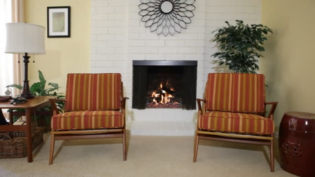 ms chairs next to fireplace in residential home / thousand oaks, california, usa - chair stock videos & royalty-free footage