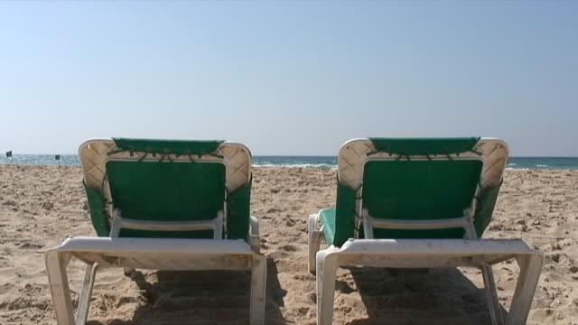 Chairs on sandy beach 3