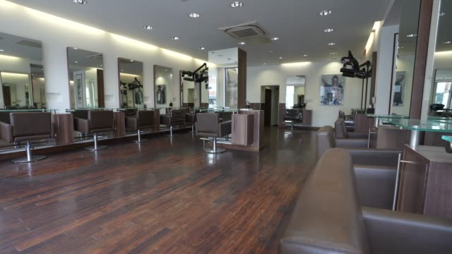 chairs sit empty at hob hair salons in finchley north london on june 17 2020 the british government have relaxed coronavirus lockdown laws... - getting away from it all stock videos & royalty-free footage