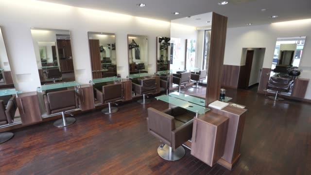 chairs sit empty at hob hair salons in finchley north london on june 17, 2020 the british government have relaxed coronavirus lockdown laws... - spa stock videos & royalty-free footage