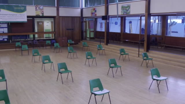 chairs spread out to observe social distancing in assembley hall as some children return to school in neath as coronavirus lockdown restrictions ease... - chair stock videos & royalty-free footage