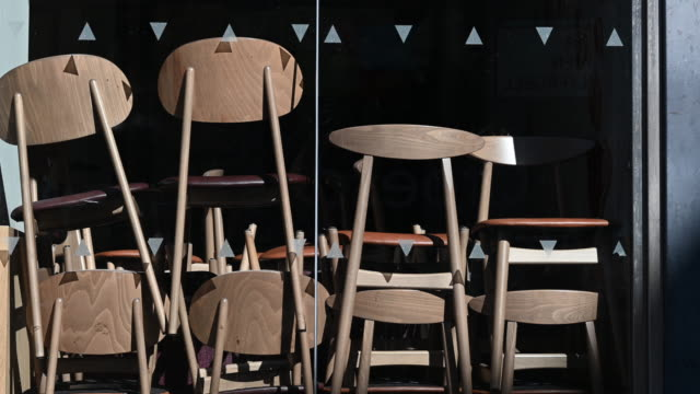 chairs stacked up in a closed coffee shop on march 28 in cardiff, wales. the coronavirus pandemic has spread to many countries across the world,... - cafe stock videos & royalty-free footage