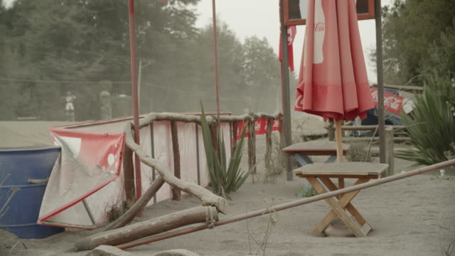 ensenada, chile - april 26, 2015: chairs, tables outside cafe covered in volcanic ash - ash stock videos & royalty-free footage