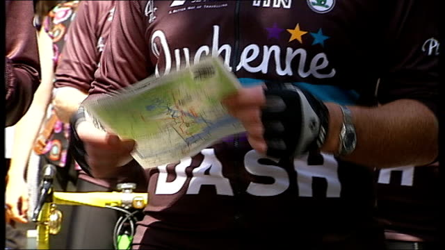 chairty bike ride from london to paris in aid of duchenne children's trust; england: london: ext low angle view group of cyclists preparing to leave... - krishnan guru murthy stock videos & royalty-free footage