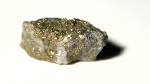 chalcopyrite mineral sample in rotation with white background - stone object stock videos and b-roll footage